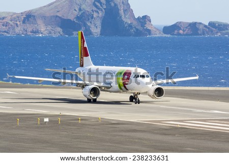 FUNCHAL, PORTUGAL - Nov 13: Passenger plane from Portuguese airline TAP prepares for take off from Funchal Airport on November 13, 2014 at Madeira, Portugal - stock photo