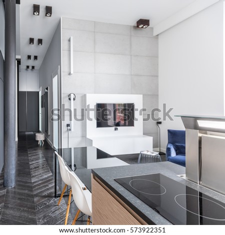 Functional kitchen with table open to living room and corridor