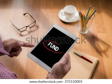 Fund Funding Donation Investment Budget Capital Concept, touch digital tablet, coffee - stock photo