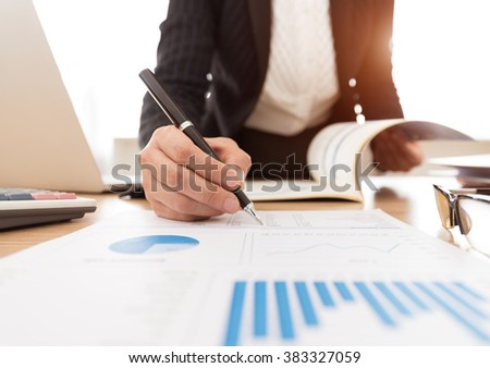 Fund Manager analyzing investment charts. concept of finance, investing, analysis business. - stock photo