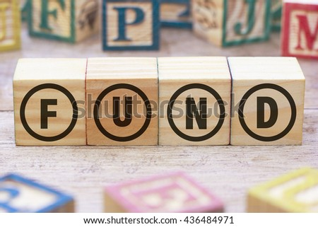 Fund word written on wood cube - stock photo