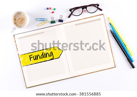 Funding text on notebook with copy space - stock photo