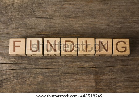 FUNDING word on wooden cubes - stock photo