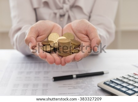 Funds manager offer golden coins to investor and the report analyzes the return on the stock market, calculator on desk. Concept of growth investment portfolio. - stock photo