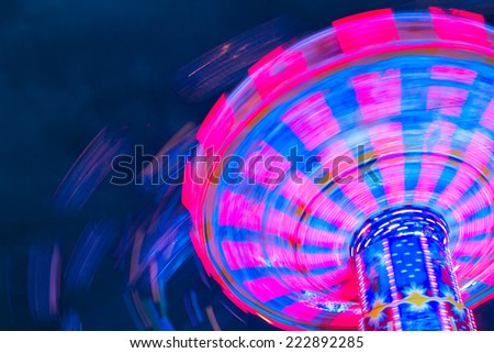 Funfair amusement park night shot - stock photo
