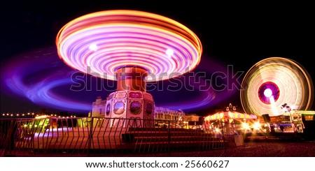 Funfair at night - stock photo