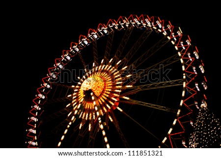 Funfair at night with shiny lights - stock photo
