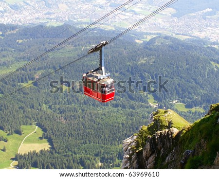 funicular. landscape with a red cable car. - stock photo