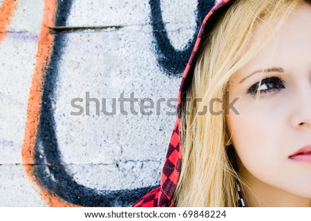 Funky and pretty girl with red cap plaid - stock photo