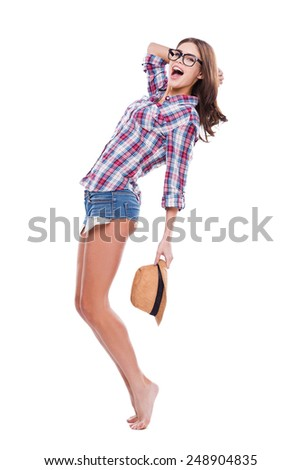 Funky beauty. Full length of attractive young woman in glasses and funky wear posing and looking at camera against white background - stock photo