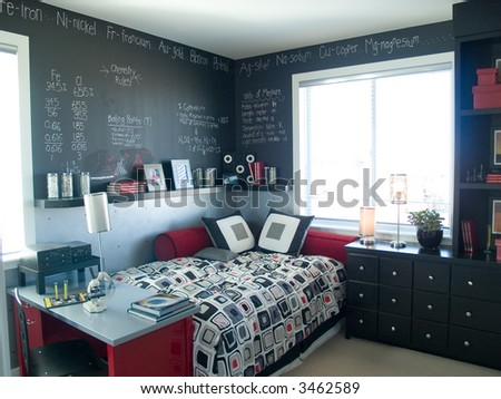 Funky bedroom with chalk board walls. - stock photo