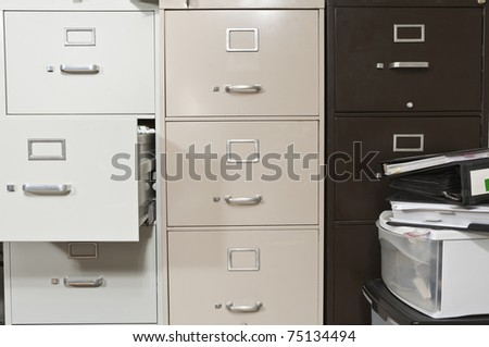 Funky file cabinets with binders boxes. - stock photo