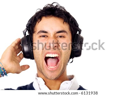 funky guy screaming while listening to music isolated over a white background - stock photo