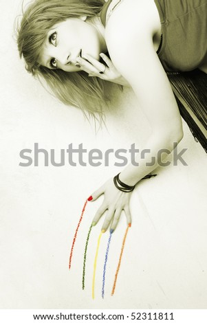 Funky image with a girl leaving colorful traces on the wall
