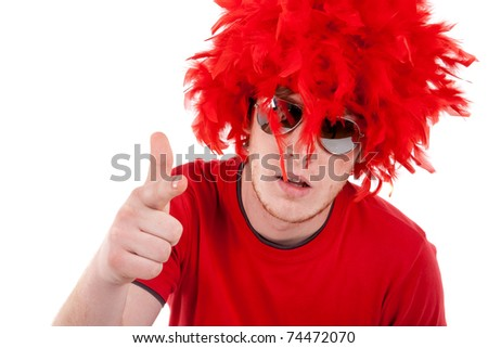 funky man with red feather wig and sunglasses, pointing to the camera