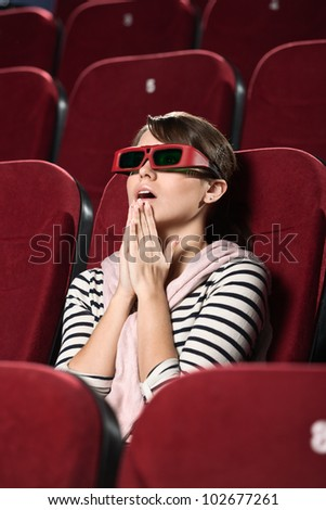 Funky woman at the 3D movie - stock photo