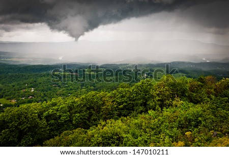 Funnel cloud and spring rainstorm over the Shenandoah Valley, seen from Skyline Drive in Shenandoah National Park, Virginia - stock photo