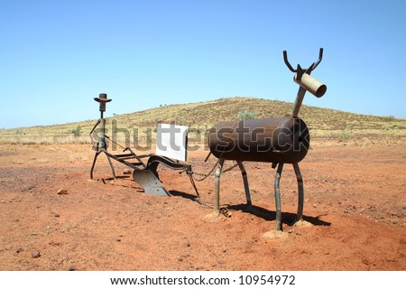 Funny agricultural sculpture with copy scape on a notice board. Australia. - stock photo