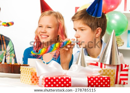 Funny and happy birthday party with teen friends - stock photo