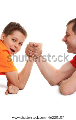 funny arm wrestling for father and son on white - stock photo