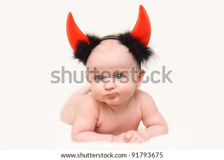 funny  baby boy dressed as a devil - stock photo