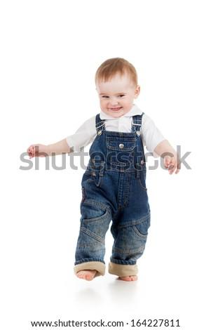 Funny baby boy is running. Studio shot. - stock photo