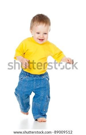 Funny baby boy running. Studio shot. - stock photo