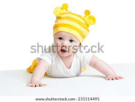 funny baby boy weared hat lying on belly - stock photo