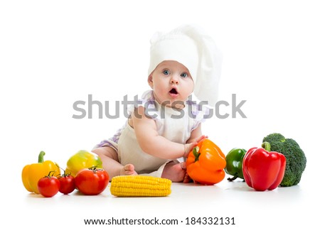 funny baby cook with healthy  food vegetables - stock photo