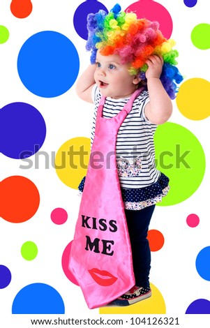 funny baby dressed as a clown with a colorful background - stock photo