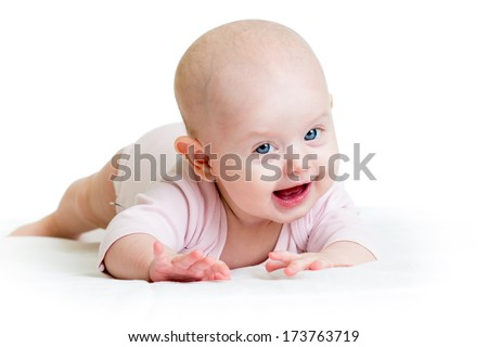 funny baby girl lying on white
