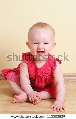 Funny baby girl (7 month) - stock photo