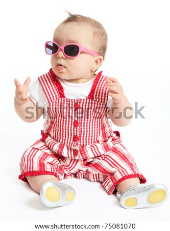 Funny baby girl wearing sunglasses - stock photo