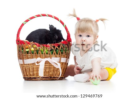 funny baby girl with Easter bunny in basket - stock photo