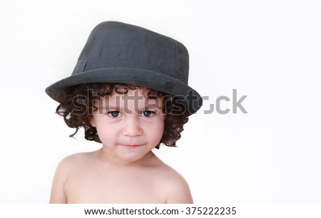 funny baby in daddy's hat  isolated on white - stock photo
