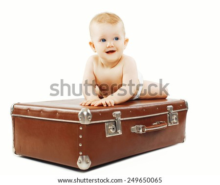 Funny baby on the suitcase - travel, family vacations concept - stock photo