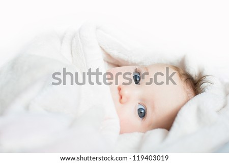 Funny baby playing peek-a-boo - stock photo