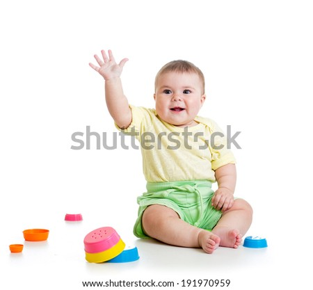Funny baby playing with toys isolated - stock photo