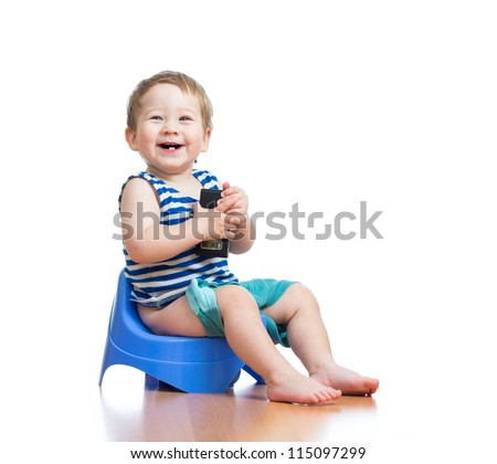 funny baby sitting on chamber pot - stock photo
