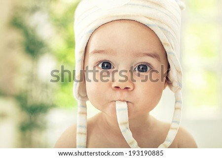 Funny baby with big eyes close up - stock photo