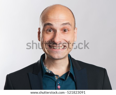 funny bald dude expressive portrait. Studio shot