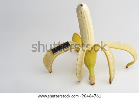 Funny Banana With Chip On White Background