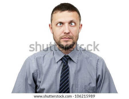 Funny bearded businessman makes funny eyes on white background - stock photo
