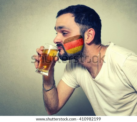 funny bearded sport fan drinking beer - stock photo