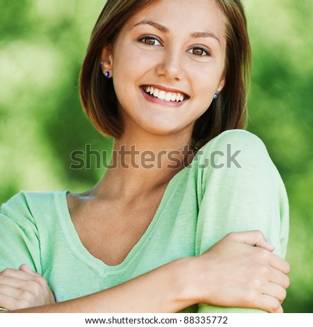 funny beautiful attractive woman snow-white smile green shirt park - stock photo