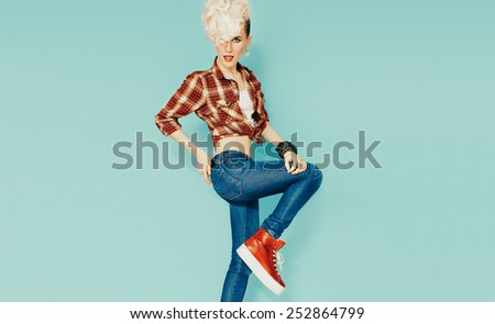 Funny Blond model with stylish Haircut on blue background. Country style, Cowboy style fashion - stock photo