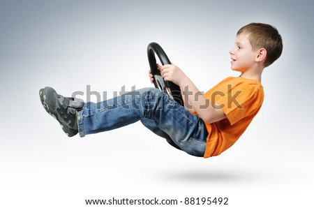 Funny boy car driver with the steering wheel, concept - stock photo