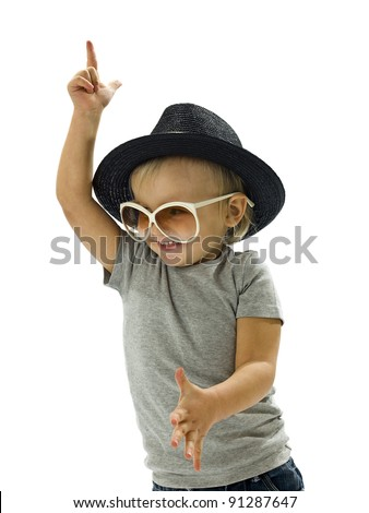 Funny boy dancing with a hat and glasses - stock photo