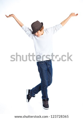 Funny boy dancing with a hat. Isolated on a white background.