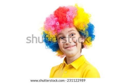 funny boy in multi-coloured wig - stock photo